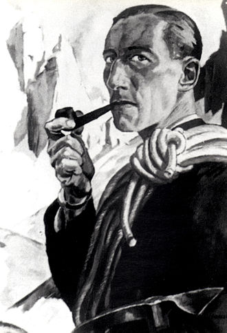 Coiling - Self-portrait of Erwin Merlet with a mountaineer's coil slung over his shoulder and the Sella Towers in the background.