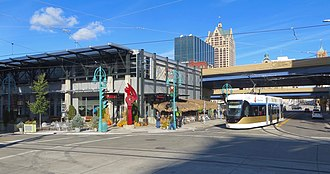 The Hop (streetcar) - A Hop car turning from Broadway onto St. Paul Avenue Avenue, passing the Milwaukee Public Market