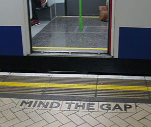 "Mind the gap - ""Mind the gap"" shaped tiling on a platform at Victoria station in London"
