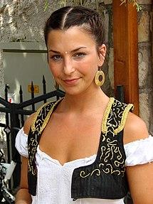 A waitress in the Old City of Mostar wearing an old Bosniak dress