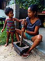 "Mother and daughter preparing Malagasy traditional plat ""Ravintoto"".jpg"