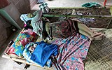 Mother and newborn sleeping on a bamboo bed near a campfire in a house in Don Det Laos.jpg