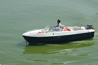Boat - A recreational motorboat with an outboard motor