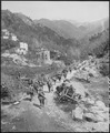 Moving up through Prato, Italy, men of the 370th Infantry Regiment have yet to climb the mountain which lies ahead. - NARA - 531277.tif