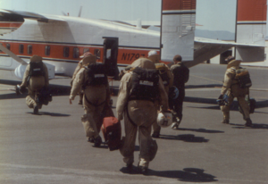 Smokejumper - Fully outfitted smokejumpers boarding an aircraft in Missoula, Montana, en route to a fire in the Idaho Panhandle, July 1994