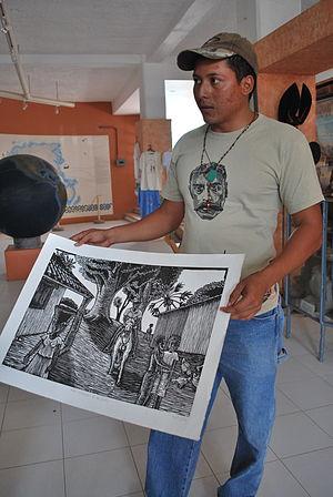 Afro-Mexicans - Artist Ramiro Victor Paz Jimenes demonstrating work at the Museo de las Culturas Afromestizas in Cuajinicuilapa, Guerrero
