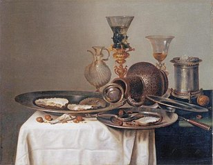 Still life with oysters, fallen jug and wine glasses