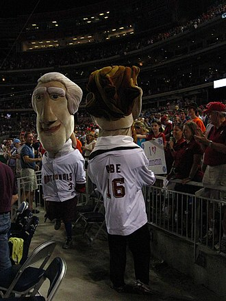 Washington Nationals - Mascots dressed as Thomas Jefferson and Abraham Lincoln in the stands during a 2010 game against the Baltimore Orioles. They compete in the Presidents Race every mid-fourth inning of a home game.