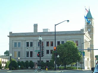 Neenah, Wisconsin - Neo-classical style Equitable Fraternal Union Building with the old City Hall clock tower behind it on S. Commercial St. (Wisconsin Highway 114).