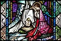 New Ross Church of St. Mary and St. Michael North Aisle Fifth Bay Left Window Our Lady of Lourdes Upper Part Detail Angel at the Foot of Our Lady of Lourdes 2012 09 04.jpg