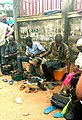 Nigerian shoe cobbler repairing damaged shoes.jpeg