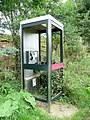 No glass, but still a working payphone - geograph.org.uk - 1456232.jpg