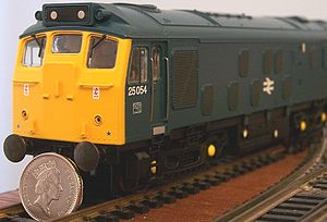 OO gauge - U.K. prototype model of a 00 scale (1:76) British Rail Class 25 shown with 22.5 mm diameter pound coin for scale