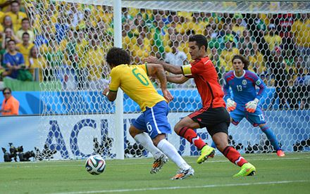 Marquez defending Marcelo at the 2014 FIFA World Cup On the day of the keeper Ochoa 04.jpg