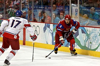 Alexander Ovechkin of the Russian men's hockey team moves the puck as Czech Republic's Filip Kuba defends against him, during the 2010 Olympics OvechkinKuba2010WinterOlympics.jpg