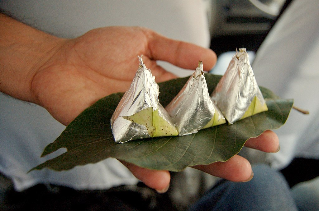 Paan, (betel leaves) being served with silver foil, India