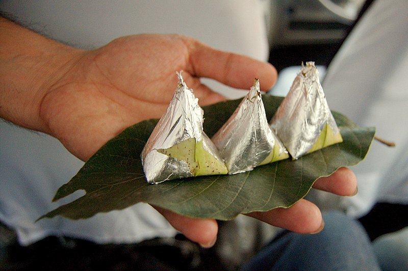 Paan, (betel leaves) being served with silver foil, India.jpg