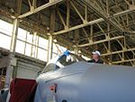 Pacific Aviation Museum - Scotty adds finishing touches. (3229229313).jpg