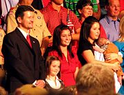Palin family members at the announcement of Palin's vice presidential candidacy. From left: Todd, Piper, Willow, Bristol, and Trig.