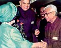 Pandit Ram Kishore Shukla with Dr. Balram Jakhar and Queen Elizabeth The Queen Mother at Buckingham Palace in 1984.jpg