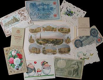 Banknoten und Luxuspapiere: kolorierter Stahlstich (um 1850), Grußkarten (1866), Ansichtskarte mit Lithografie (1902), bedruckte Pappkärtchen für Fotos (um 1900).