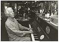 Pianist Henk Schilp achter de piano in Bistro De Torenvalk in de Warmoesstraat. NL-HlmNHA 54036482.JPG