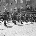 Pipers of the 51st Highland Division play during the ceremony to mark the handover of Bremerhaven in Germany to American forces, 20 May 1945. BU6560.jpg