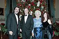 President George H. W. Bush and Barbara Bush pose for a picture with Tom Selleck and his wife at a reception for Kennedy Center Honorees.jpg