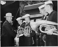 President Harry S. Truman thanks members of the ship's band after one of their concerts on the U. S. S. Augusta off... - NARA - 198723.tif