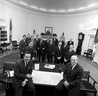 Larry E. Temple - President Johnson posing with staff 1969. Larry Temple standing 2nd row, 2nd from left.