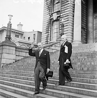Keith Holyoake - Prime Minister-elect Holyoake leaving Parliament Buildings with the Clerk of the Executive Council, on the way to Government House. Photographed on 12 December 1960 by an ''Evening Post'' staff photographer.