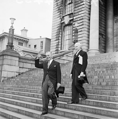 Prime Minister-elect Holyoake leaving Parliament Buildings with the Clerk of the Executive Council, on the way to Government House. Photographed on 12 December 1960 by an Evening Post staff photographer. Prime Minister-elect Keith Holyoake leaves Parliament Buildings.jpg