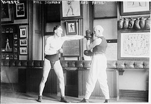 Professor Mike Donovan - Professor Mike Donovan (on right) helping someone train, c.1910's