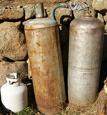 English: 2 larger propane tanks, one with a re...