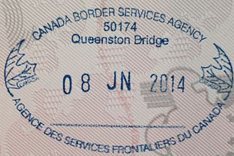 Canadian English - Canadian passport stamp from Queenston Bridge, showing the date 8 June 2014.