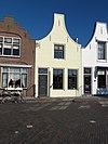 foto van Huis met gepleisterde klokgevel