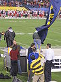 Rally Comm flagbearer celebrates Cal TD at 2009 Poinsettia Bowl 1.JPG