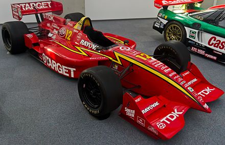 Target-Chip Ganassi Racing would win four consecutive CART drivers championships with Jimmy Vasser (1996, car pictured), Alex Zanardi (1997 and 1998), and Juan Pablo Montoya (1999). Reynard 96I right Honda Collection Hall.jpg
