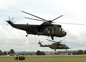 RNAS Yeovilton (HMS Heron) - A Sea King HC4 (foreground) accompanied by a Merlin HC3 of the Commando Helicopter Force at RNAS Yeovilton.