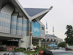 Shah Alam Museum with the Blue Mosque's minarets in the background.