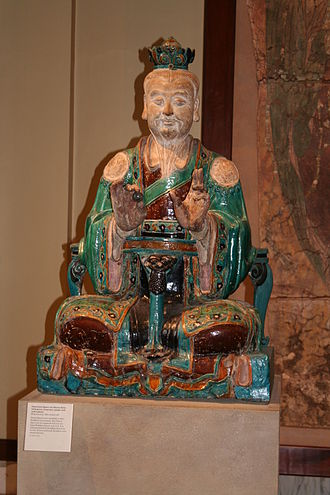 Chinese philosophy - Chinese glazed stoneware statue of a Daoist deity, from the Ming Dynasty, 16th century.