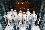 STS-82 crew members pose in their clean room suits (5134454299).jpg