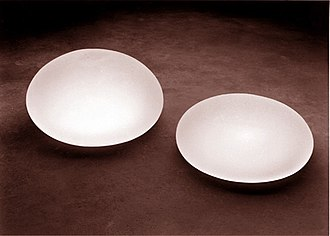 Breast augmentation - Breast augmentation: saline-solution filled breast implant devices, a spherical model (left) and a hemispheric model (right).