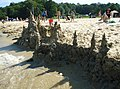 Sandcastle seen from lake with people in background.jpg