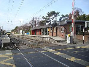 Sandymount railway station - Sandymount station looking North with the main building on right and a Northbound DART on platform 1.