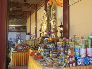 Ghosts in Chinese culture - An array of foods being offered to the deceased during Ghost festival