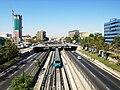 Santiago landscape Metro and Panamericana.jpg