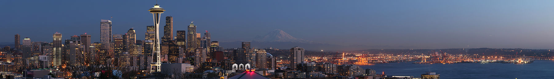 The Seattle skyline at dusk with Mt Rainier in the distance