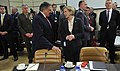 Secretary of Defense Leon E. Panetta chats with Norwegian Minister of Defense Anne-Grete Hjelle Strøm-Erichsen prior to the start of the NATO Ministers of Defense meeting at NATO Headquarters in Brussels.jpg