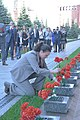 Serena Auñón-Chancellor lays flowers where Russian space icons are interred.jpg